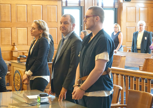 """Zyrian Atha-Arnett stood with his defense lawyer, Jon Paul Rion, during his sentencing Wednesday, July 21, in the 2019 stabbing death of Leonid """"Lonya"""" Clark. Atha-Arnett pleaded guilty to involuntary manslaughter as part of a plea deal with the Greene County Prosecutor's Office, and was sentenced to 15 years in prison for that and other charges. (Photo by Carol Simmons)"""
